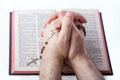 Male hands closed in prayer Royalty Free Stock Photography