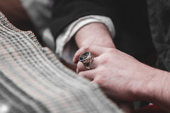 Male hands closeup. On finger vintage ring Stock Photo