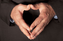 Male hands closeup. Man in suit folded hands in as a heart closeup Royalty Free Stock Photo
