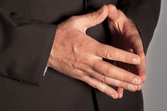 Male hands closeup. Man in suit folded hands in as a pyramid closeup Royalty Free Stock Photography