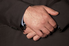 Male hands closeup. Man in suit folded his hands in front of him closeup Stock Image