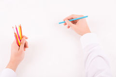 Male hands with colored pencils. Creative work. Male hands holding colored pencils and ready to start drawing Stock Photos