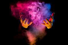 Male hands from colorful smoke Stock Photo