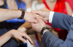 Male hands during the contest. Male and female hands, the contest Find a bride Royalty Free Stock Photo