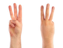 Male hands counting. Number 3 Stock Photo