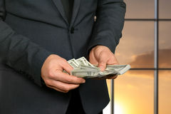 Male hands counting american dollars. Royalty Free Stock Photography