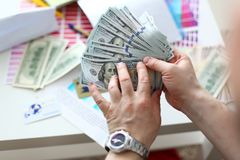 Male hands counting money from huge pack stock image
