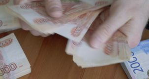 Male hands counting money. Russian money banknotes of 5,000 rubles stock video