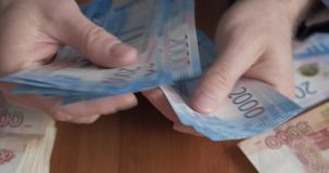 Male hands counting money. Russian money banknotes of 2,000 rubles stock video
