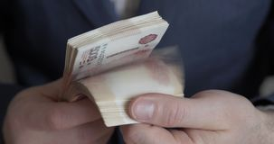 Male hands counting money. Russian money banknotes of 5,000 rubles stock video footage