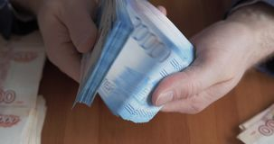 Male hands counting money. Russian money banknotes of 2,000 rubles stock footage