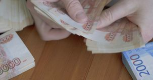 Male hands counting money. Russian money banknotes of 5,000 rubles. Close-up footage of male hands counting money. Russian money banknotes of 5,000 rubles stock video