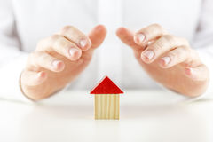Male hands covering and protecting a home Stock Photography