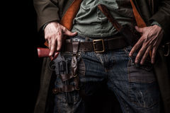 Male hands cowboy and revolver on belt Royalty Free Stock Image