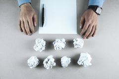 Male hands with crumpled papers and document on table stock image