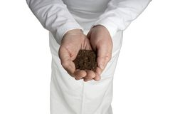 Male Hands Cupped Open w black dirt soil sod Royalty Free Stock Images