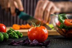 Male hands cutting vegetables for salad. Close up on male hands cutting carrot, making salad. Chief cutting vegetables. Healthy lifestyle, diet food Stock Photo