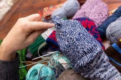 Male hands darn wool socks Royalty Free Stock Photos