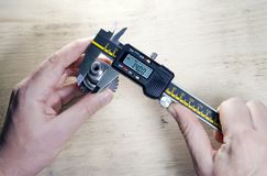 Male hands with digital caliper.  royalty free stock photography
