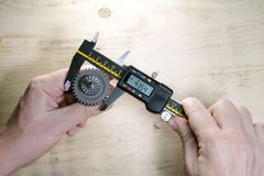 Male hands with digital caliper.  royalty free stock image