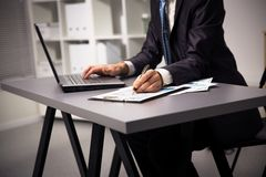 Male hands doing paperwork with pen Royalty Free Stock Image