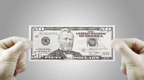 Male hands with dollars. Male hands with 50 dollars isolated on a white Stock Images