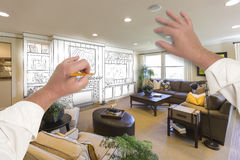 Male Hands Drawing Entertainment Center Over Photo of Home Inter Stock Images