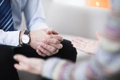 Male hands with elegant watch. Close-up of male hands with an elegant watch and his female therapist`s hands Stock Photo