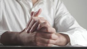 Close up of male hands expressing fear and anxiety. Man wrings hands nervously