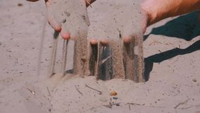 Male Hands Falling Sand on the Beach in Slow Motion. Dirty sand in the hands of men. Male Hands Falling Sand on the Beach in Slow Motion 180 fps. Sand grains stock video