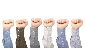 Male hands in fists in different shirts on white background stock photography