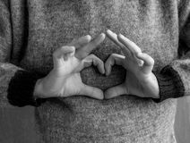 Male hands folded in the shape of a heart. Royalty Free Stock Photography
