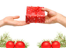 Male hands give a christmas present Stock Image