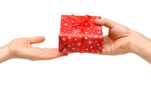 Male hands give a christmas present Stock Images
