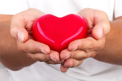 Male hands giving red heart Stock Photography