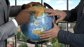 Male hands and globe. Two businessmen on city background. Maintain peace and order. New plan of actions stock video