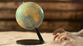 Male hands grab the globe. A man`s hand reaches out to the globe and captures it stock footage