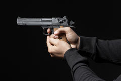 Male hands with gun isolated on black Stock Images