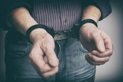 Male hands handcuffed Stock Image