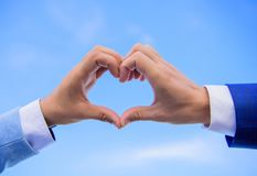 Male hands in heart shape gesture symbol of love and romance. Love symbol concept. Hand heart gesture forms shape using. Fingers. Hands put together in heart stock photography