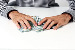 Male hands hold dollars Stock Images