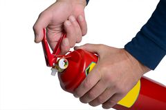 Male hands hold a fire extinguisher Royalty Free Stock Images