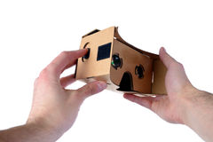 Male hands hold VR glasses isolated on white background.  Royalty Free Stock Photography