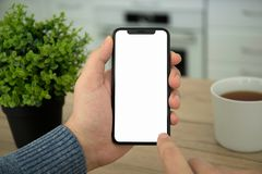Male hands holding black touch phone with  screen Royalty Free Stock Photo