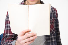 Male hands holding blank notebook. Closeup portrait of a male hands holding blank notebook Stock Image