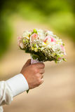 Male hands holding a bouquet royalty free stock photo