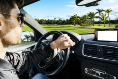 Male hands holding car steering wheel. Hands on steering wheel o stock photo
