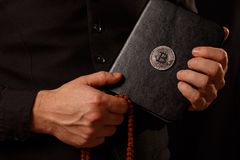 Male hands holding an crypto bible with Bitcoin logo Royalty Free Stock Image