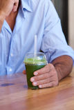Male hands holding cup of healthy green juice stock photos