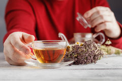 Male hands holding cup with hot herbal tea. Winter and Christmas Royalty Free Stock Photo